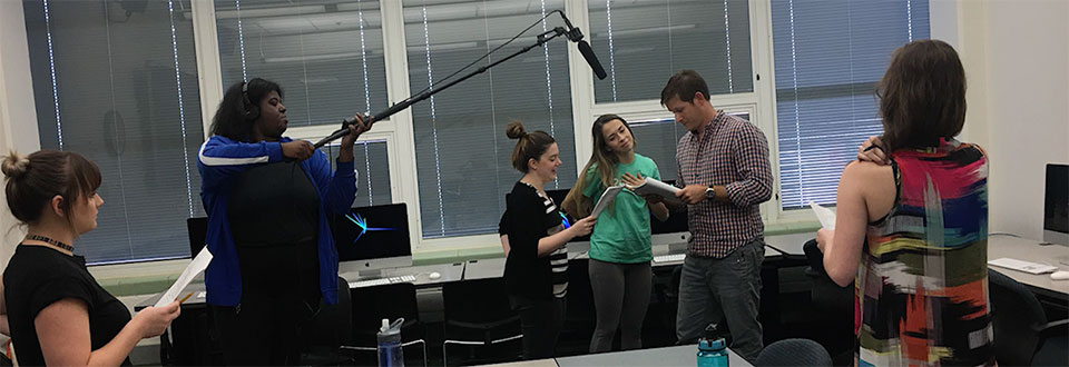 Students working with professor as actors read the final script