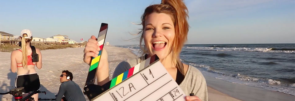 Student prepping scene on location in Gulf Shores Alabama for a student film