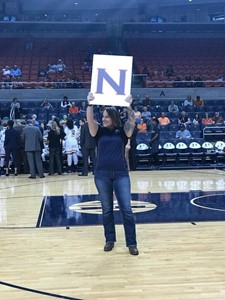 Heather Ralson holding an N sign to spell out Auburn