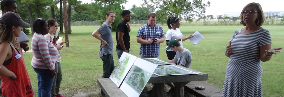 students at park discussing plans