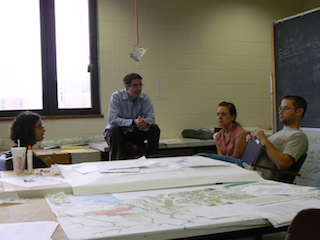 students looking at maps