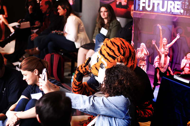 AU Theatre Scholarship Day; visiting and parents gathered in the Telfair Peet Theatre lobby; a student poses with Aubie.