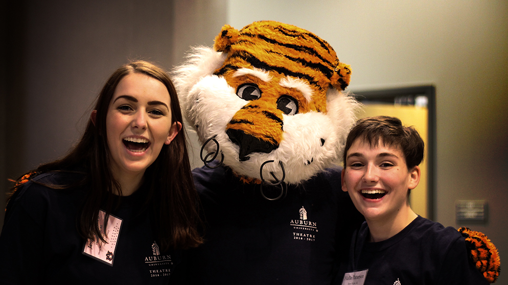 Two students pose with Aubie on AU Theatre Scholarship Day